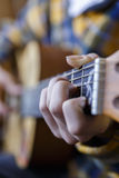 Young guy playing classical guitar Royalty Free Stock Photography