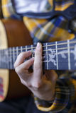 Young guy playing classical guitar Stock Photo