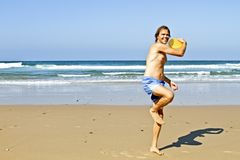 Young guy playing with frisbee Royalty Free Stock Image