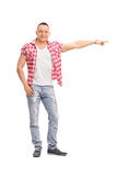 Young guy pointing right with his hand Royalty Free Stock Images