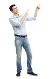 Young guy pointing up Stock Images
