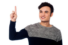 Young guy pointing upwards Stock Image