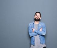 Young guy posing on gray background Royalty Free Stock Images
