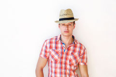 Young guy posing with hat against white background Royalty Free Stock Photos