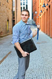 Young guy posing with a laptop Stock Images