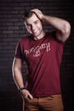 Young guy posing. Young guy in a t- shirt posing Royalty Free Stock Photography