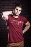 Young guy posing. Young guy in a t- shirt posing Stock Images