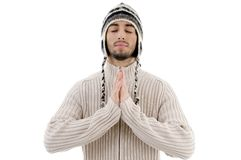 Young guy praying with joined hands Stock Photography