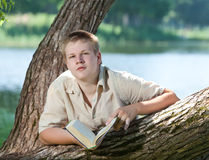 Young guy prepare for lessons, examination in spring park Royalty Free Stock Image