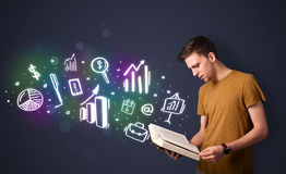 Young guy reading a book with business icons Royalty Free Stock Images