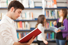 Young guy reading a book Stock Photography