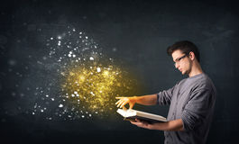 Young guy reading a magical book Stock Image