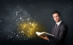 Young guy reading a magical book Royalty Free Stock Photography