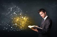 Young guy reading a magical book Stock Photos