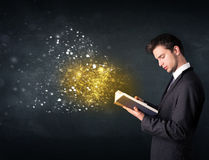 Young guy reading a magical book Stock Photo