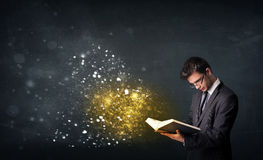 Young guy reading a magical book royalty free stock image
