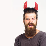Young guy with red horns Royalty Free Stock Photography