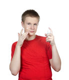 The young guy in a red t-shirt to put cosmetic cream on a face.Portrait on a white background Stock Photos