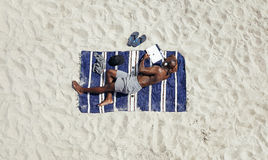 Young guy relaxing on beach Stock Photo
