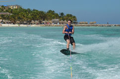Young Guy Riding a Wakeboard on the Ocean off Aruba Stock Image