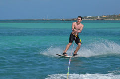 Young Guy Riding a Wakeboard Off the Coast of Aruba Royalty Free Stock Photography