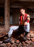 Young guy on the ruins Royalty Free Stock Photography