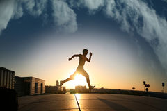 Young guy running during sunset Royalty Free Stock Images