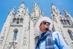 A young guy in a scarf, hat near the Temple of the Sacred Heart Stock Photos