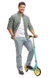 Young guy with a scooter Stock Image
