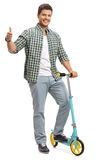 Young guy with a scooter making a thumb up gesture Stock Photography