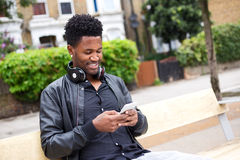 Young guy sending a text message Royalty Free Stock Image