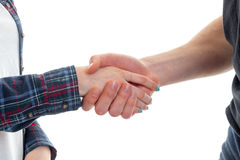 Young guy shakes the hand of a girl close-up Stock Photos