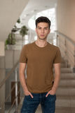 The young guy in a shirt and jeans Royalty Free Stock Photo