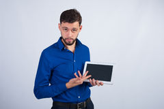 Young guy showing the tablet stock photography
