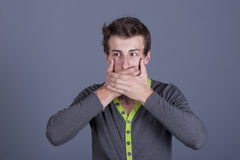 Young guy shut your mouth Stock Image