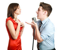 Young guy singing to a pretty girl Stock Photo