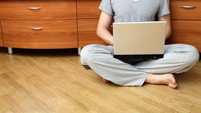 Young guy sitting on the floor and working Stock Photo