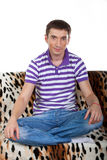 Young guy sitting in the lotus position Royalty Free Stock Photos