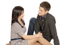 A young guy sitting next to a girl Royalty Free Stock Photo