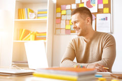 Young guy studying at home Stock Images