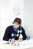 A young guy studying at home Stock Images