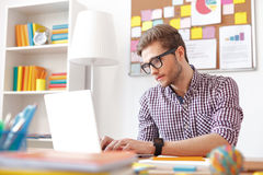 Young guy studying at home Royalty Free Stock Photography