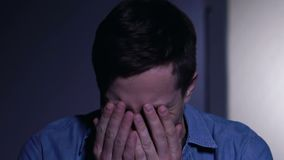 Young guy suffering schizophrenia, hearing voices in head, mental disorder. Stock footage stock footage