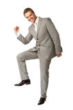 Young guy in suit clenching his fist in triumph Royalty Free Stock Images