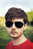 Young guy in sunglasses close-up outdoors Royalty Free Stock Photos