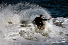 Young guy surfing Stock Image