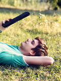 Young guy with a tablet outdoors Stock Images