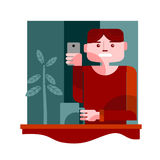 Young guy takes a selfie. Young guy taking self portrait using a camera phone inside a coffee shop royalty free illustration
