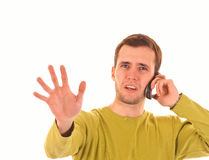 Young guy talking by mobile. Young guy is talking by mobile royalty free stock image