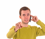 Young guy talking by mobile. Young guy is talking by mobile phone stock photography